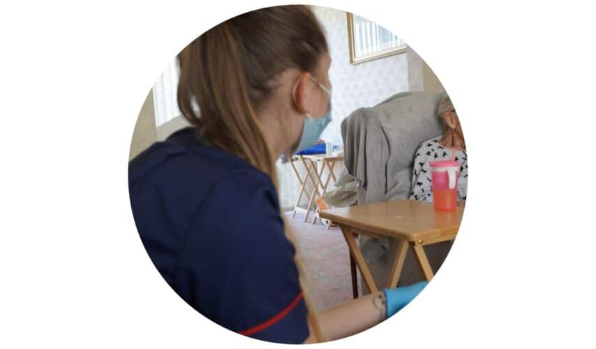 Carer sitting and listening to client