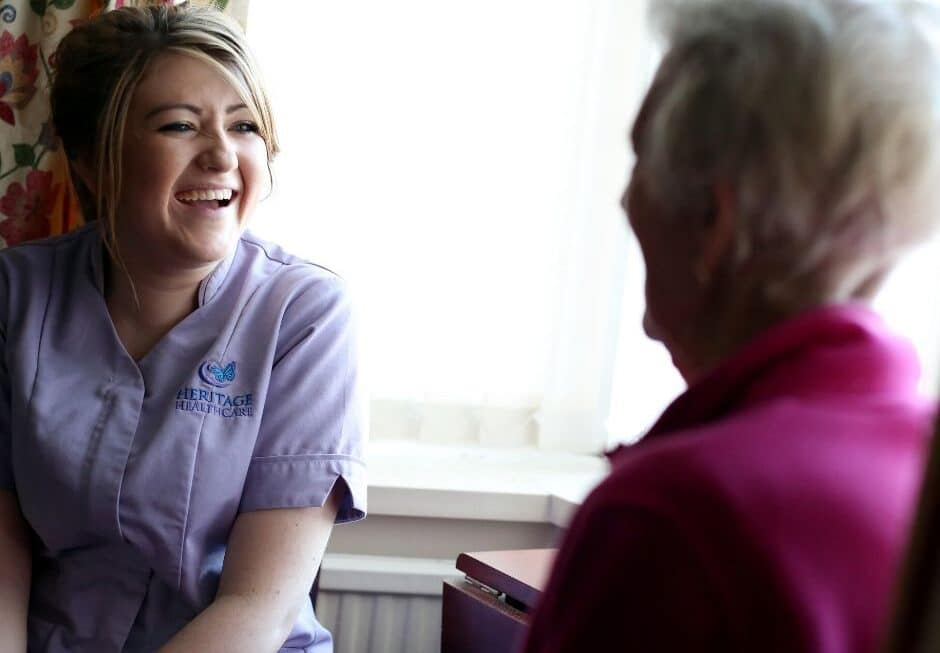 Female carer laughing with client