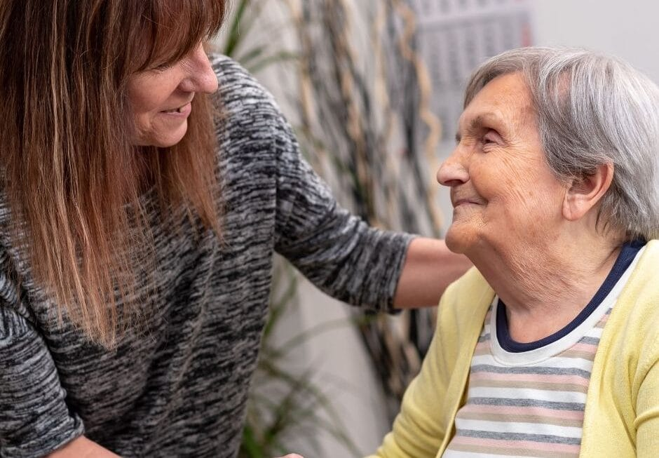 female carer supporting an elderly lady