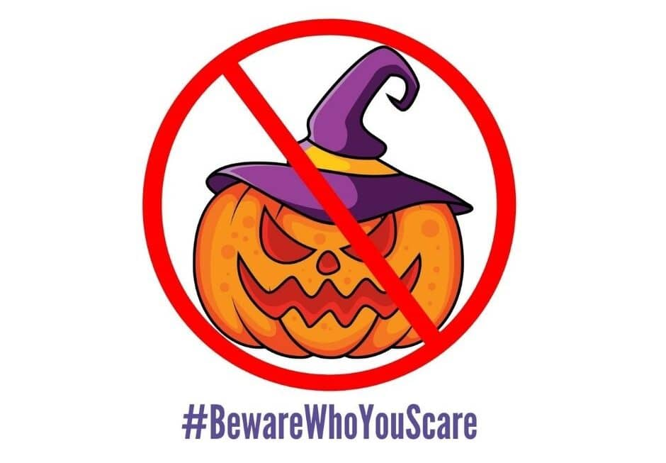 cary pumpkin in a witches hat with a red prohibition symbol over the top and purple text underneath which read '# beware who you scare'